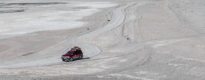 Jeep on a road in the Salar de Uyuni, Bolivia royalty free stock photo