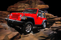Jeep Rock Crawl. A red Jeep climbing rocks. See my portfolio for more automotive images royalty free stock images