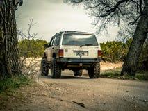 Jeep Rock Crawling alaranjado fotografia de stock
