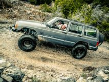 Jeep Rock Crawling orange images stock