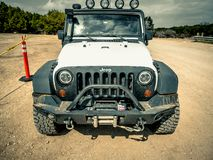 Jeep Rock Crawling orange photo stock