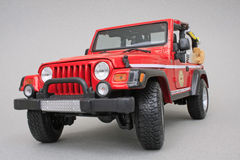 Jeep Rubicon Brush Fire Unit. Jeep Rubicon, Maisto Premiere Edition 1:18 scale diecast, left front view Stock Photos