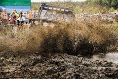 A vehicle`s racing in mud during an off-road racing competition. Royalty Free Stock Images