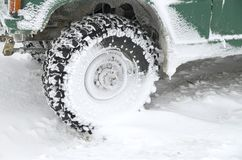 Jeep`s tire in snow in winter. Closeup royalty free stock photos
