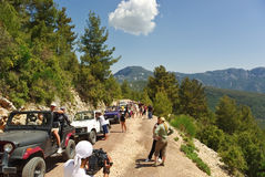 Jeep safari. Tourists, participants of Jeep safari  having rest during climb to the Olimpos mountains, near Kemer, Turkey. Current position is 1000 meters high Royalty Free Stock Photography