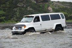 Jeep during Safari. Jeep driving through river during safari Stock Photography