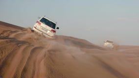 Jeep Safari in the Arabian desert. Car view on jeeps driving among desert tracks at sunset. DUBAI UNITED ARAB EMIRATES - JANUARY 12 2019: Jeep Safari in the stock video