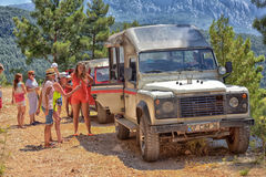 Jeep safari in the mountains on the road Stock Images