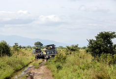 Jeep-safari with people stuck on the washed out roads. AFRICA, TANZANIA, MAY, 08, 2016 - Jeep-safari with people stuck on the washed out roads in Tarangire Royalty Free Stock Photography