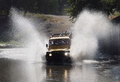 Free Jeep Safari Through River Royalty Free Stock Photography - 21370507