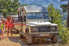 Jeep safaris on the mountain roads in the vicinity of Kemer, a lot of jeeps parked. Royalty Free Stock Photo