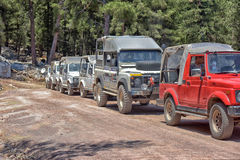 Jeep safaris on the mountain roads in the vicinity of Kemer, a lot of jeeps parked. Kemer, Antalya, Turkey - 21.07.2015 : Jeep safaris on the mountain roads in Royalty Free Stock Images