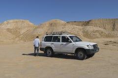 Jeep on Sahara desert Stock Image