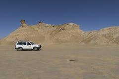 Jeep on Sahara desert Stock Photos