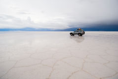 Jeep in the salt lake royalty free stock photos