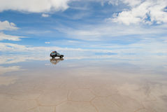 Jeep in the salt lake salar de uyuni Royalty Free Stock Image