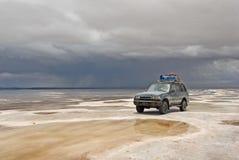 Jeep in the salt lake salar de uyuni, bolivia stock images