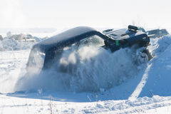 Jeep in the snow. In the field Stock Image