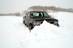 Jeep in snowdrift Royalty Free Stock Images