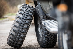 Jeep tires. Jeep changing tires, big wheels stock photography