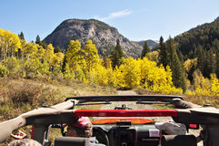 Red Jeep in Fall foliage mountains Royalty Free Stock Photos