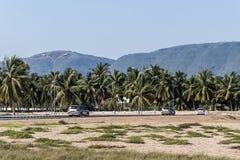 Jeep tour street in front of palms and dhofar Mountains Salalah Oman stock photos