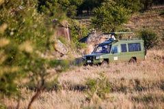 Jeep with tourists on safari in Serengeti, Tanzania, Africa. stock image