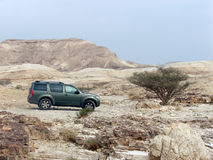 Jeep trip. Jeep vehicle on background of great landscape of Negev desert Stock Images