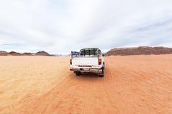 Jeep in the Wadi rum desert. Jordan with car. Jeep in the Wadi rum desert. Traveler concept royalty free stock photo