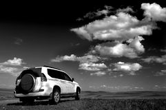 Jeep and white clouds Royalty Free Stock Photography