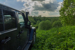 Jeep Wrangle. Leningrad region, Russia - June 10, 2017. Jeep Wrangler on a hill in the Leningrad region. The jeep Wrangler is a compact SUV produced by Chrysler Royalty Free Stock Photos