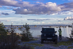 Jeep wrangler on the coast of the Gulf of Finland, Karelian isthmus, Russia Stock Photo