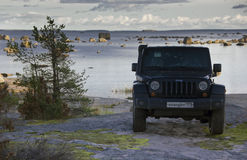 Jeep wrangler on the coast of the Gulf of Finland, Karelian isthmus, Russia Royalty Free Stock Images