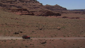 Jeep wrangler driving on rough terrain stock video footage