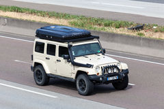 Jeep Wrangler Unlimited Sahara with a roof tent Stock Photos