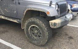 Jeep Wrangler 4x4 with Muddy Chasis Stock Photos