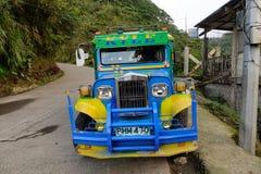 Jeepney在农村路的汽车停车处在Ifugao,菲律宾 库存图片