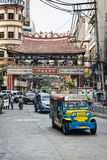 Jeepney and busy street traffic in central manila chinatown phil Stock Photos