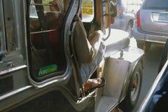 Public transportation Jeepney stuck in traffic jam in Manila Philippines stock photos