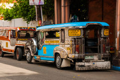 Jeepney parking on street in Manila, Philippines. Stock Photography