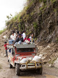 Jeepney surfing. People riding on the top of a jeepney in the philippines Stock Images
