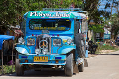 Jeepneys passing, Filipino inexpensive bus service. Philippines. Stock Photos