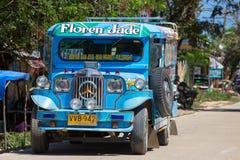 Jeepneys passing, Filipino inexpensive bus service. Philippines. Stock Photos