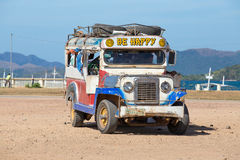 :Jeepneys passing, Philippines inexpensive bus service. Royalty Free Stock Images
