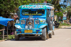Jeepneys passing, Philippines inexpensive bus service. Royalty Free Stock Images