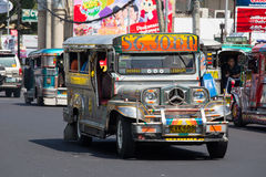 Jeepneys passing in Philippines. Stock Photo