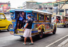 Jeepneys on street in Manila, Philippines Stock Photography