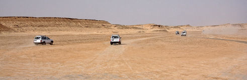Jeeps  in desert Stock Photos