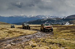 Jeeps driving on muddy surface Stock Images