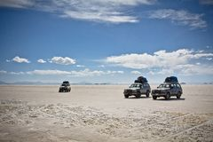 Jeeps in the landscape of the Salar de Uyuni and lagoons like La royalty free stock image